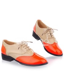 Oxfords are still a good bet if you want shoes that will stay 'in'. To modernize, try a bright pair like this one from Milanoo.